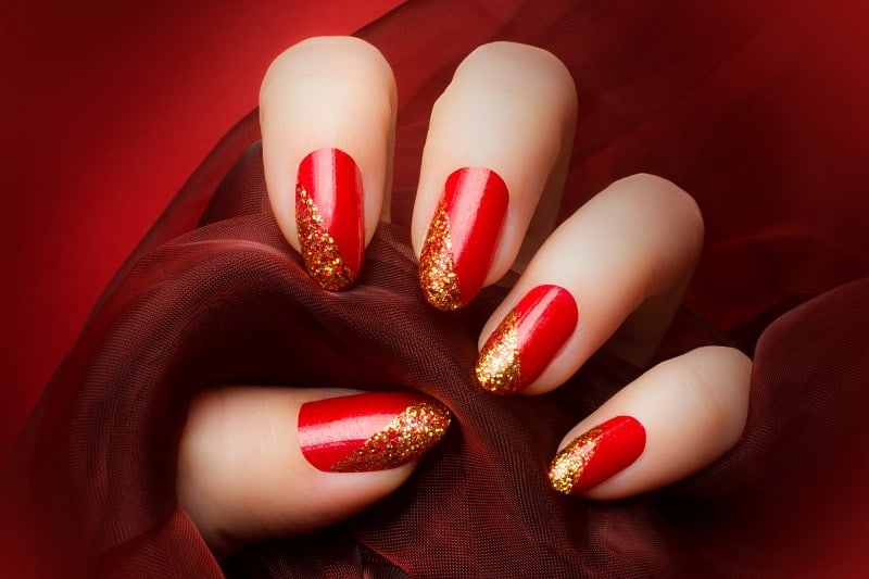 Red Oval Nails With A Pop Of Gold At The Tip