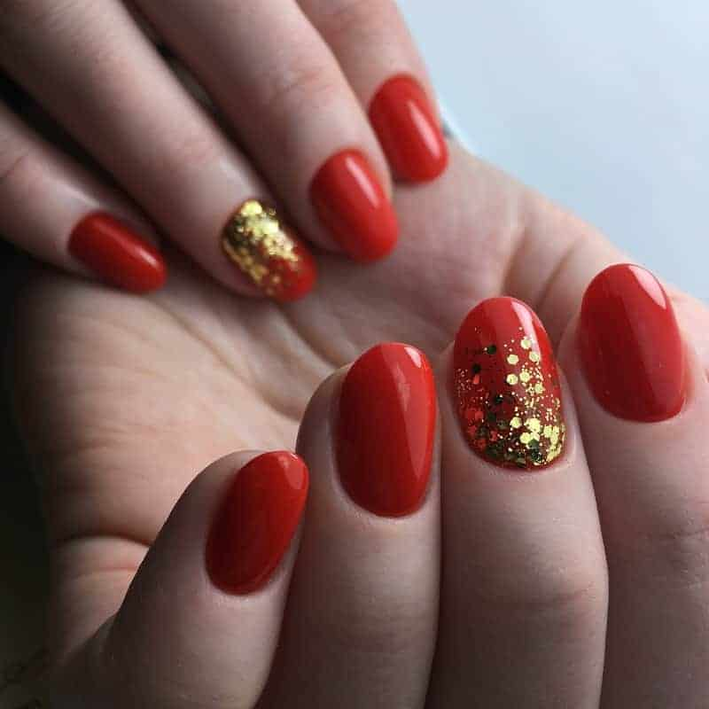 Short And Natural Red Nails With Gold Glitter