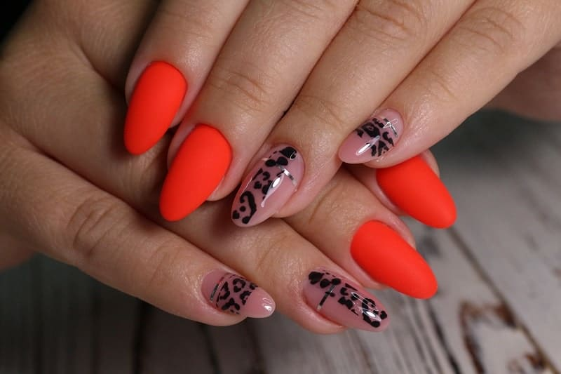 Short Oval Bright Red Nails With Black Prints