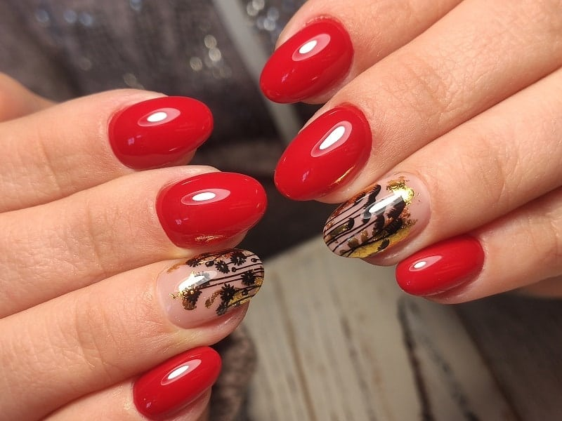 Short Oval Red Nails With Black Golden Design