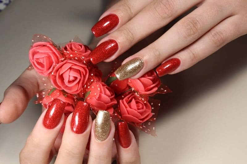 Square Shaped Red Nails With A Hue Of Gold On Ring Fingers