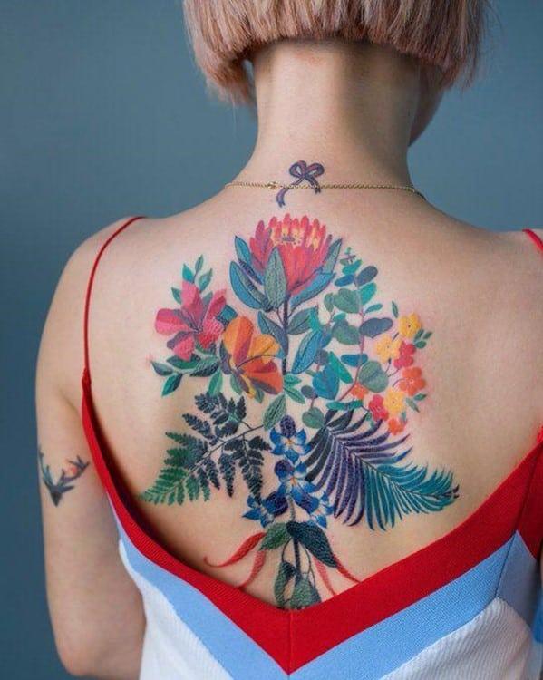 Dramatic, Colorful & Feminine Back Flower Tattoo