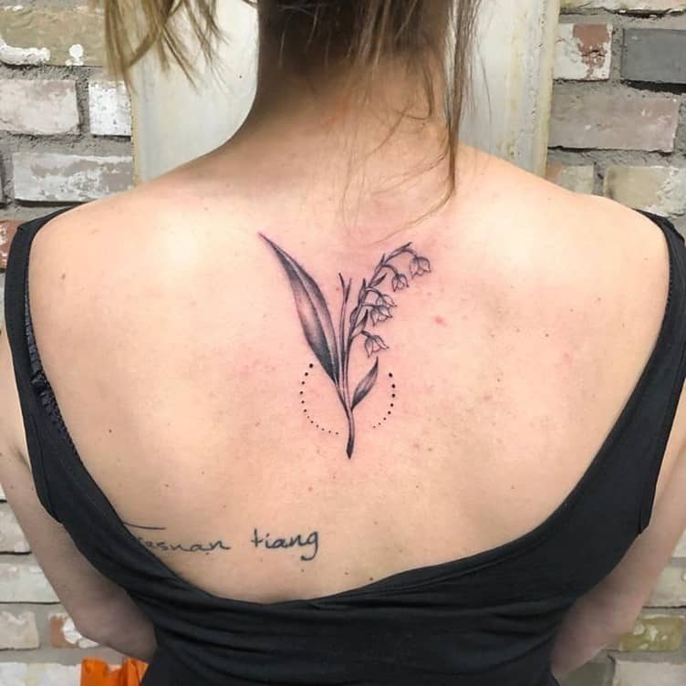 Delicate Lilly of The Valley Back Tattoo