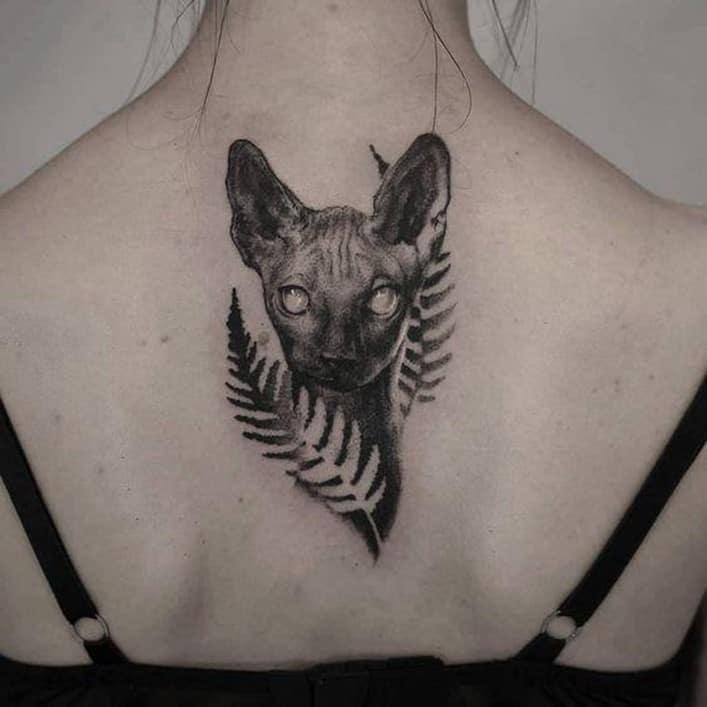 Small & Cute Cat Back Tattoo