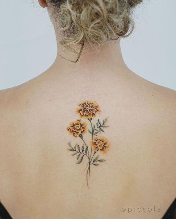 Small Yellow Flower Tattoo Over Back