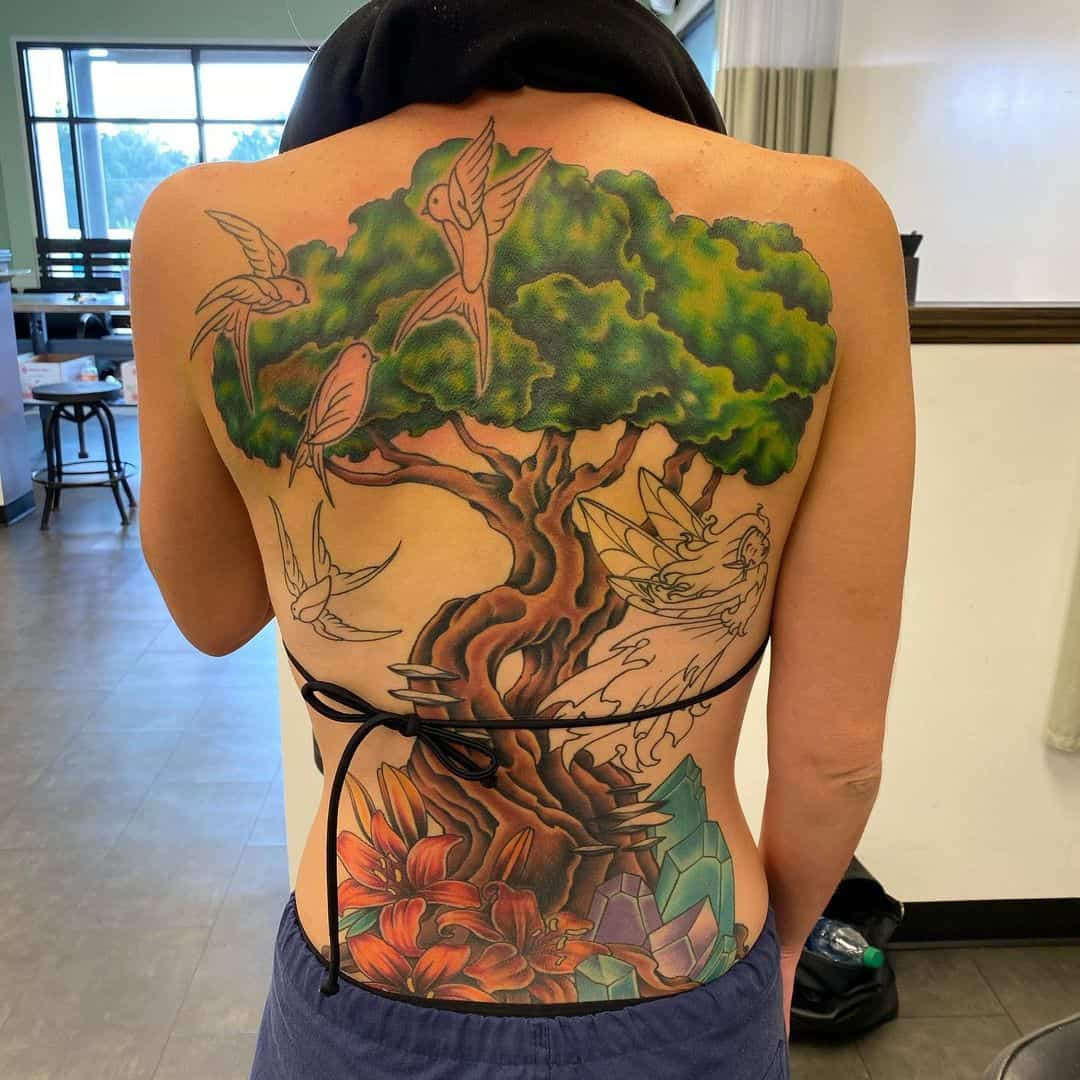 Gorgeous Nature Inspired Green Tattoo Over Back