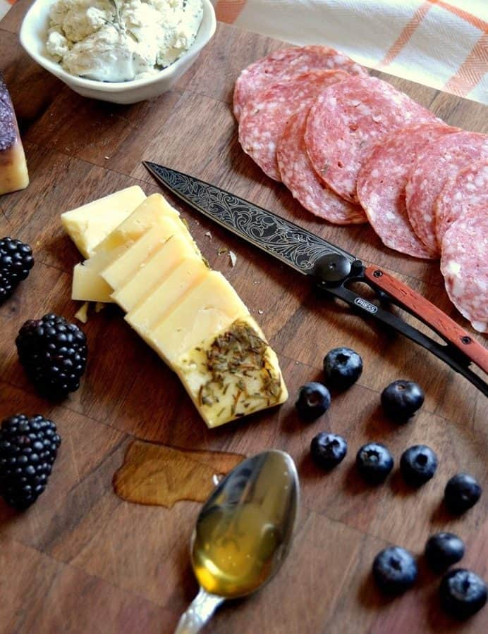 CHEESE, CHEAP WINE, AND TATTOOED KNIVES