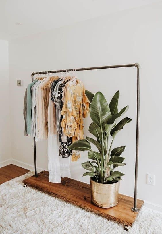 6. Dark Wood Element Inspired Clothing Rack