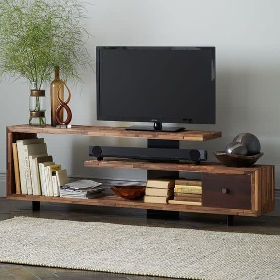 7. Unique Shaped TV Stand With Detailed Elements