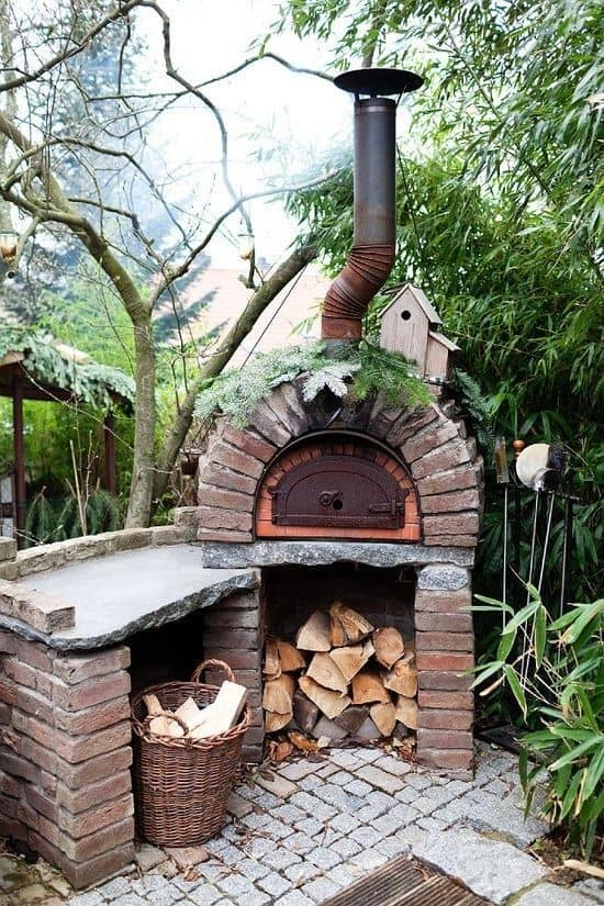 . Outdoor And Mystical Wood Inspired Pizza Oven