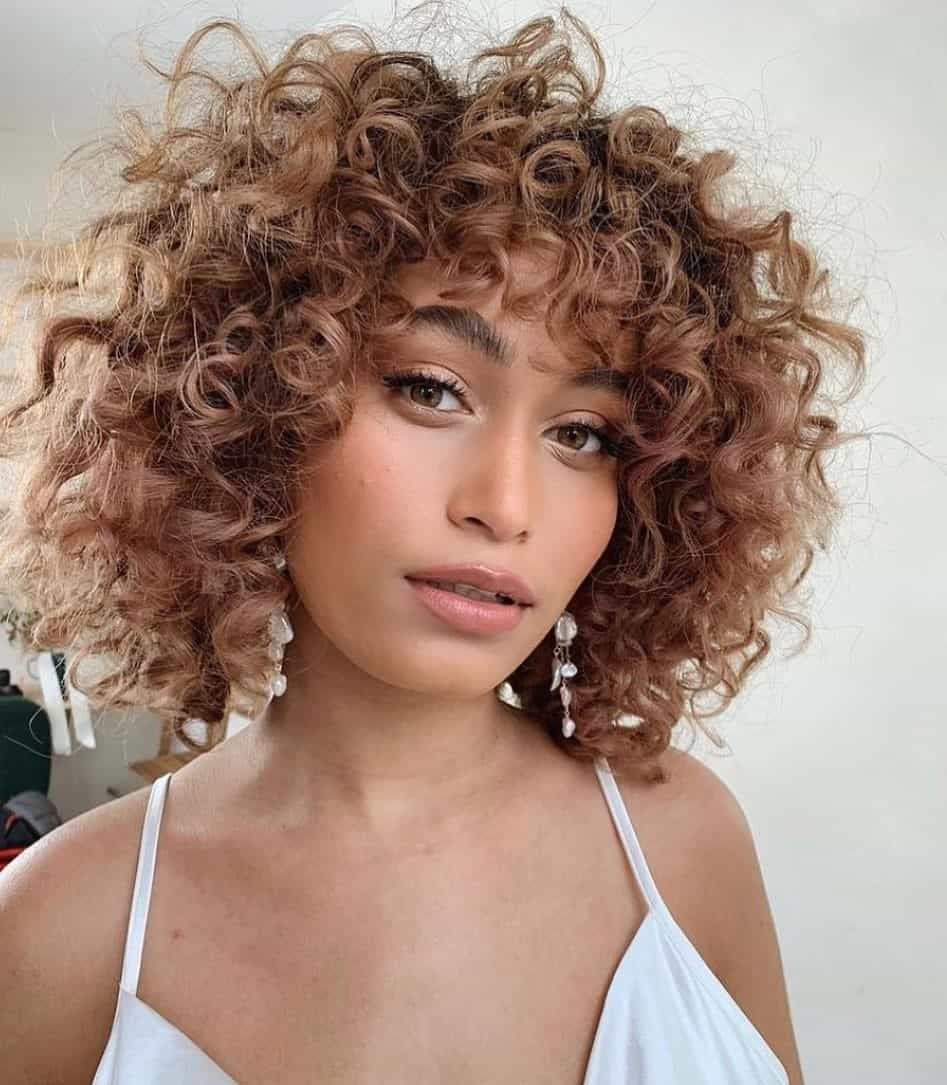 Curly Feminine Cut For Women With Round Faces