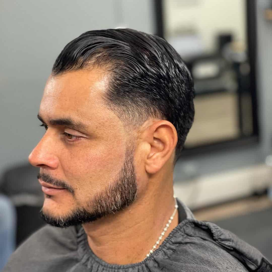 Slicked Back Cut Wet Hair Look
